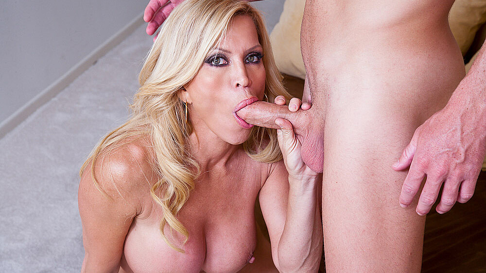 Amber Lynn fucking in the couch with her tits