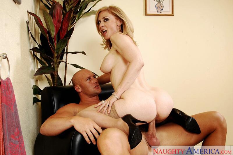 Porn star Mrs. Hartley giving a blowjob