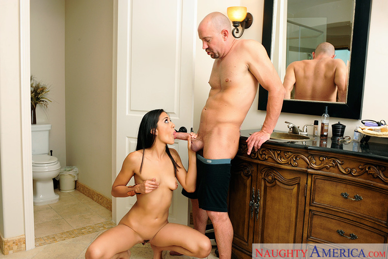 Porn star Lyla Storm giving a blowjob