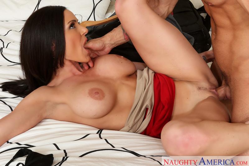 Porn star Kendra Lust giving a blowjob
