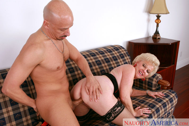 Porn star Mrs. Jewell giving a blowjob
