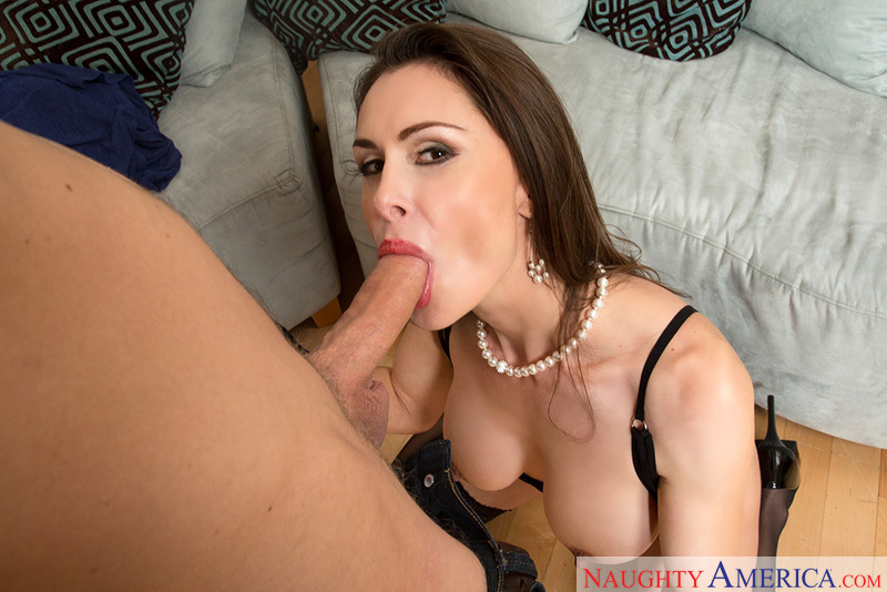 Porn star Nora Noir giving a blowjob