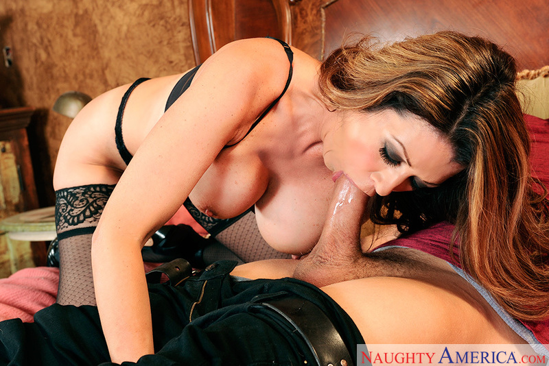 Porn star Raquel DeVine giving a blowjob