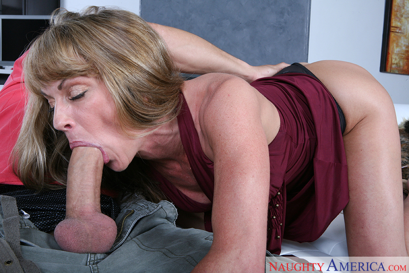 Porn star Mrs. Laveaux giving a blowjob