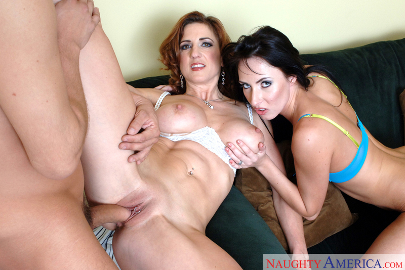 Porn star Mrs. Isis & Mrs. Noir giving a blowjob