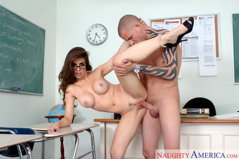 Porn star Mrs. Rossi giving a blowjob