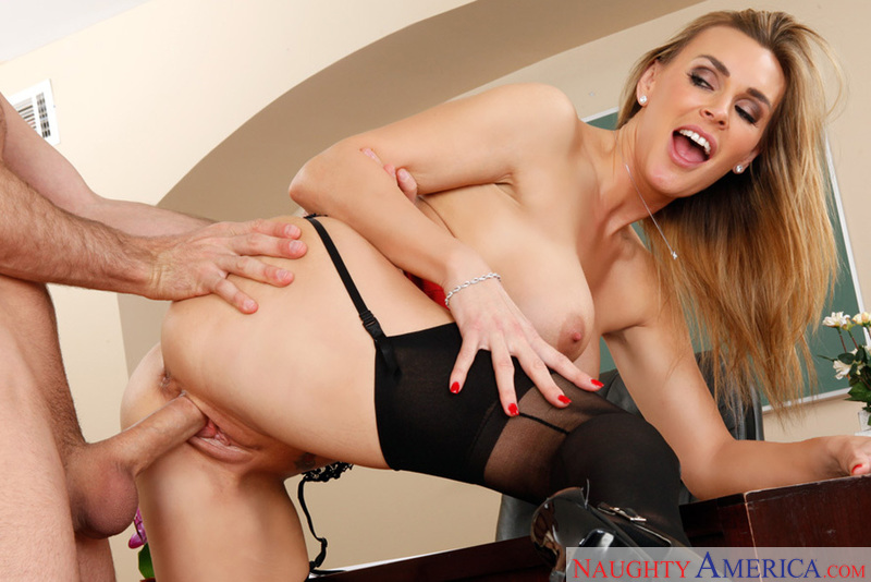 Porn star Tanya Tate giving a blowjob