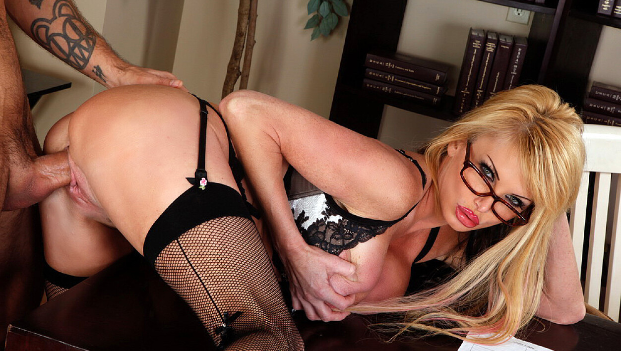 Mature Taylor Wane fucking in the desk with her glasses