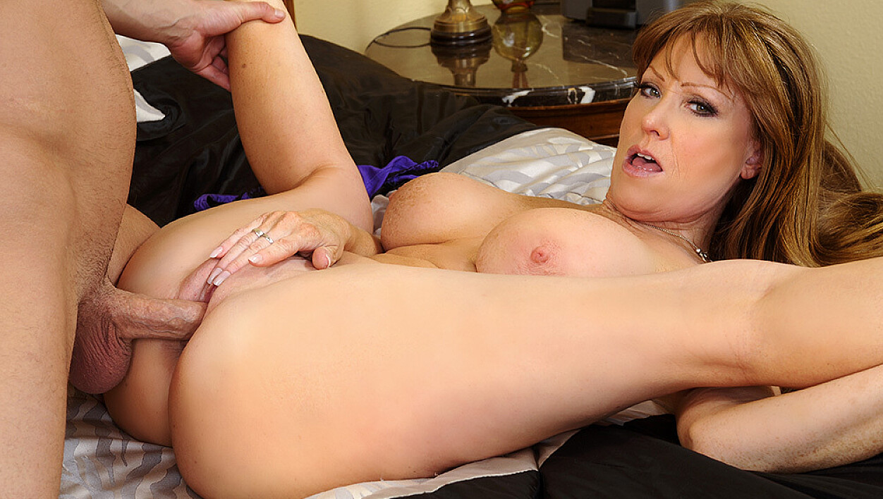 Cougar Darla Crane fucking in the bed with her big tits