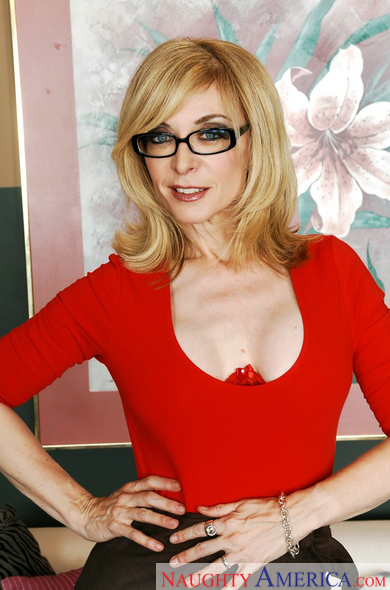 MILF Nina Hartley fucking in the couch with her glasses