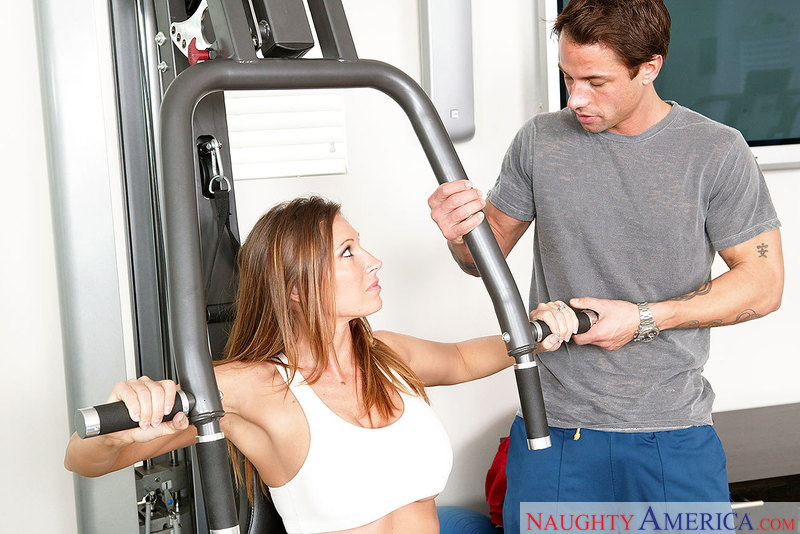 Blonde gym trainer helps her client with his cardio 4